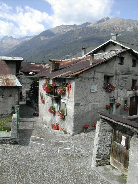 Bormio is a typically beautiful Alpine town, with ancient stone houses, their gray exteriors enlivened by bright flowers