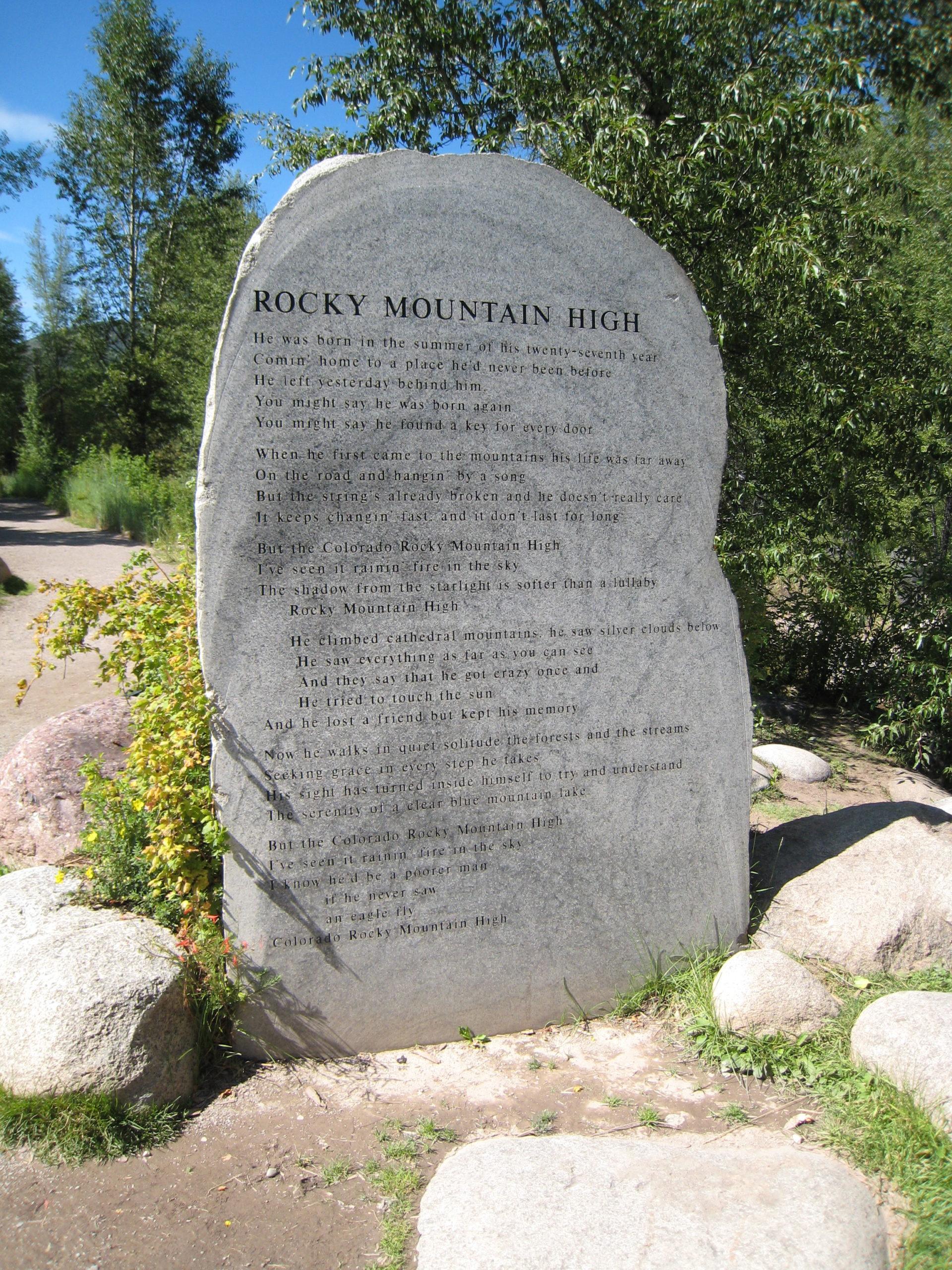 "lyrics to John Denver's ""Rocky Mountain High"" carved into a rock in Aspen, CO"