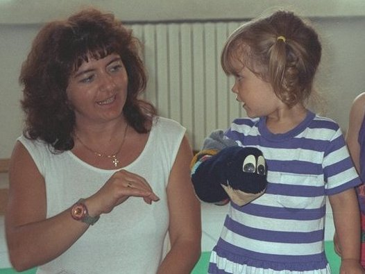 Rossella age 3 at asilo nido (daycare) with teacher.