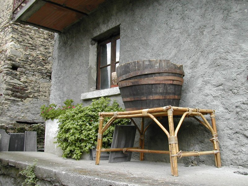 balcony with old barrell, Italian Alpine village