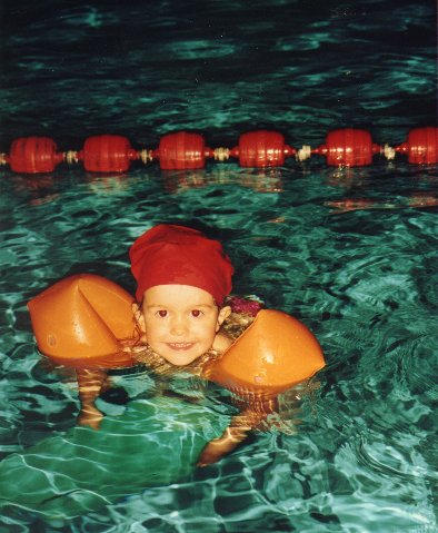 Rossella age 3 in swimming class.