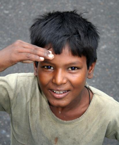 Indian street kid saluting