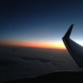sunset over a plane wing