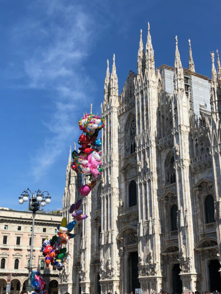 string of bright balloons in front of the Duomo, Milan.