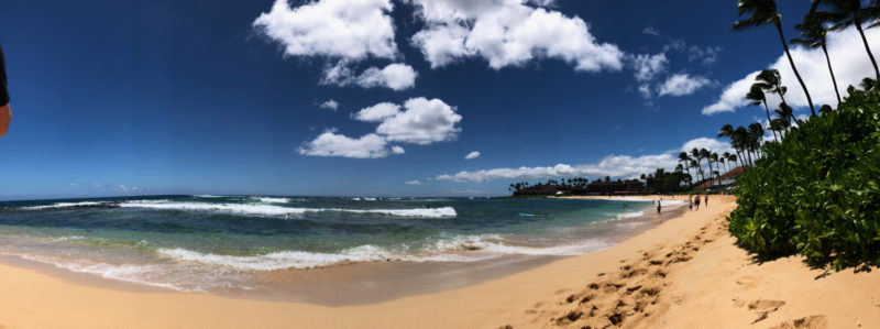 panoramic view of Poipu Beach, Kaua'i.
