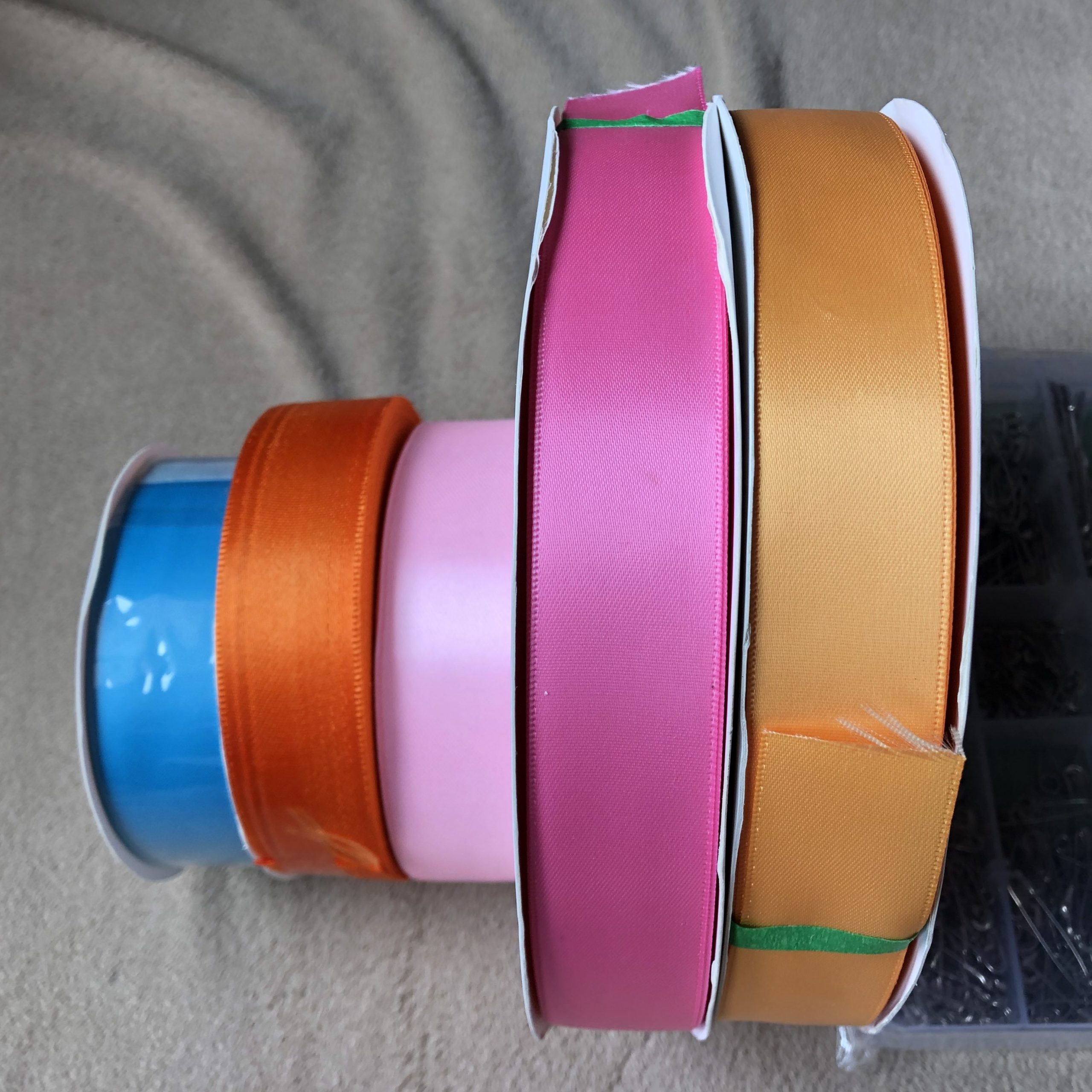 rolls of colored ribbon