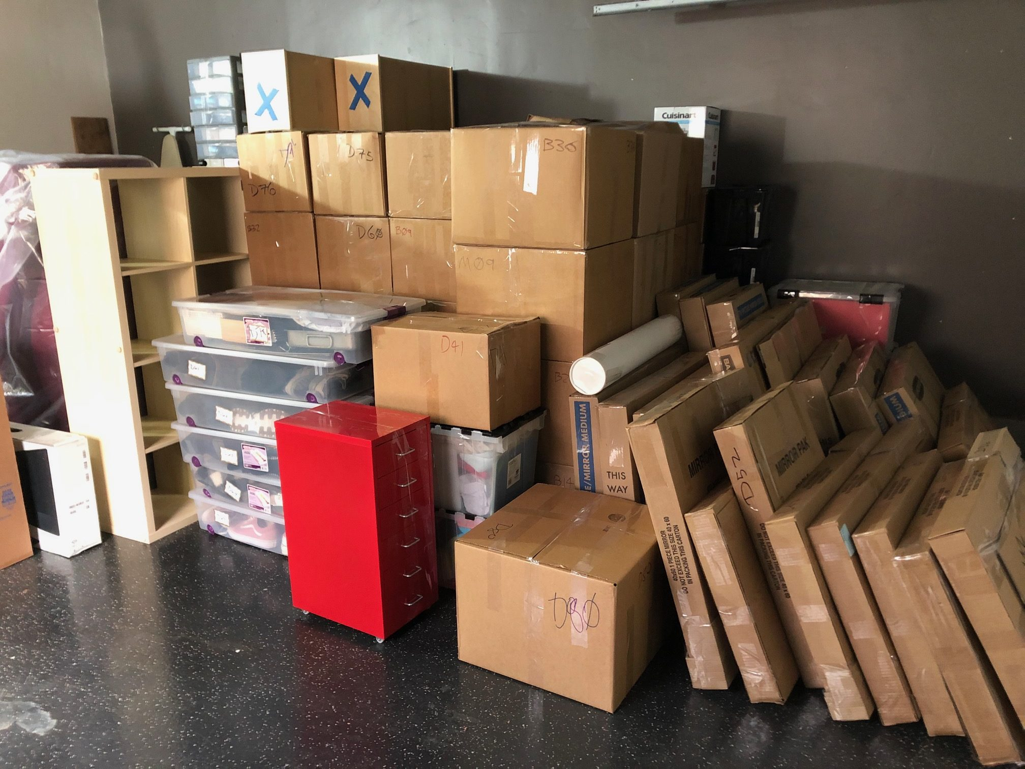 boxes and furniture piled in the garage