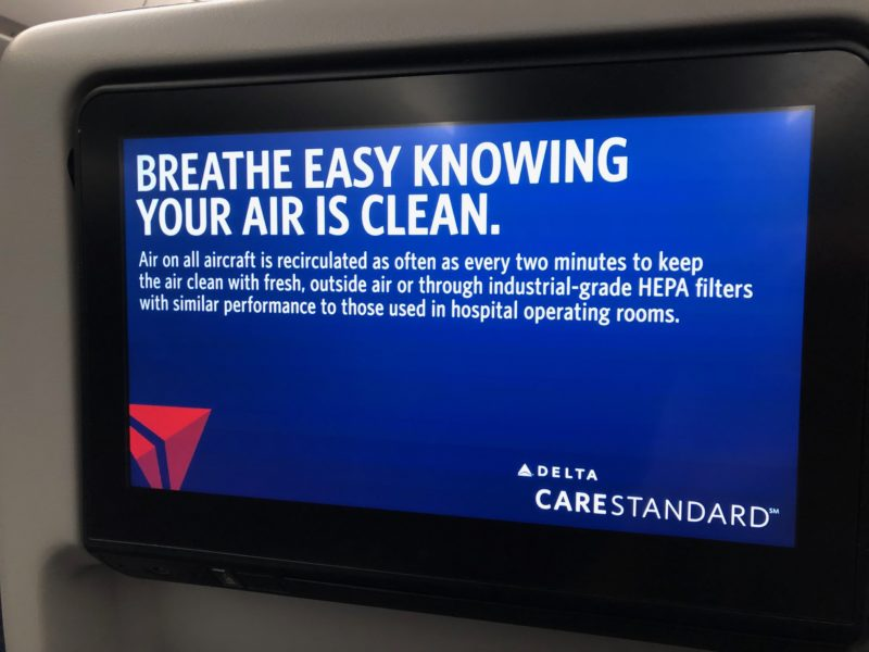 "sign on Delta's in-flight entertainment system saying ""Breathe easy knowing your air is clean"""