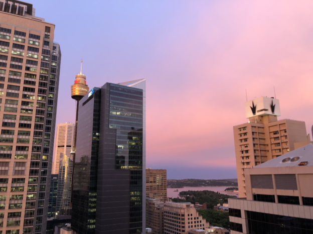 pink sunset clouds through tall buildings in Sydney CBD