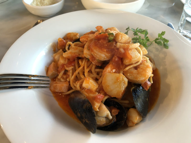 bowl of spaghetti with seafood and tomato sauce